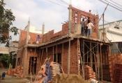 Làm gì khi hàng xóm xây nhà làm nứt tường nhà mình?