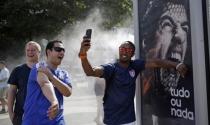Adidas ngừng quảng cáo với Luis Suarez vì cắn người