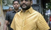 Tài phiệt dệt may Ấn Độ mặc áo vàng 4kg