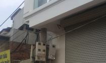 Tháo dỡ cột điện xuyên nhà ở Hà Nội