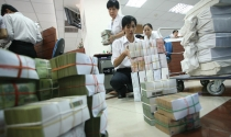 Giao dịch ngân hàng: vẫn trên các bao tải tiền