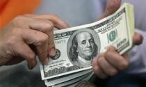 Fed tuyên bố vẫn duy trì gói cứu trợ và lãi suất thấp