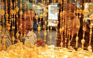 Giá vàng đánh mất thành quả tăng vì ECB cắt giảm gói mua trái phiếu