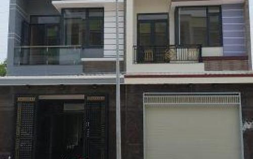 Nhà 2 lầu gần chợ Đông Hòa, nhà mới, đường nhựa rộng 20m..