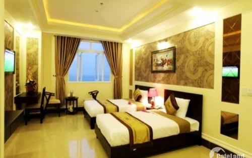 Bán nhà mặt tiền đường Nguyễn Văn Linh, Tân Thuận Tây, Quận 7, diện tích : 20x32, GPXD hầm, lửng 9, lầu